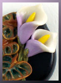 One-of-a-kind bead with hand-sculpted calla lilies and leaves