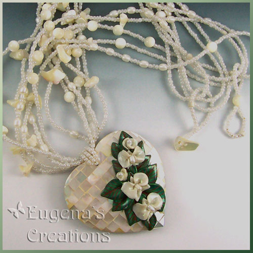 One-of-a-kind necklace with white hand-sculpted orchids