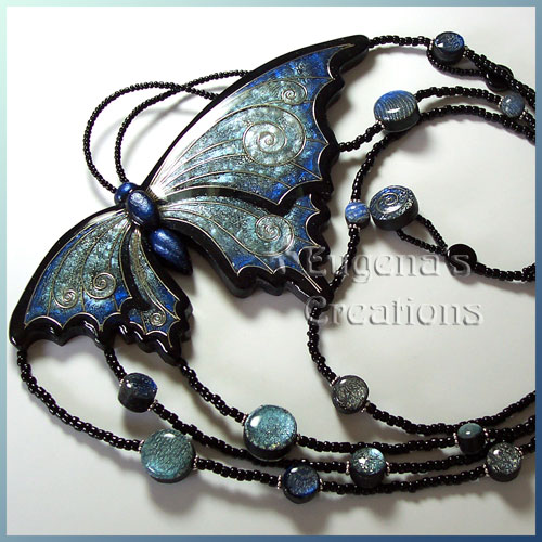 One-of-a-kind necklace with blue faux cloisonne butterfly