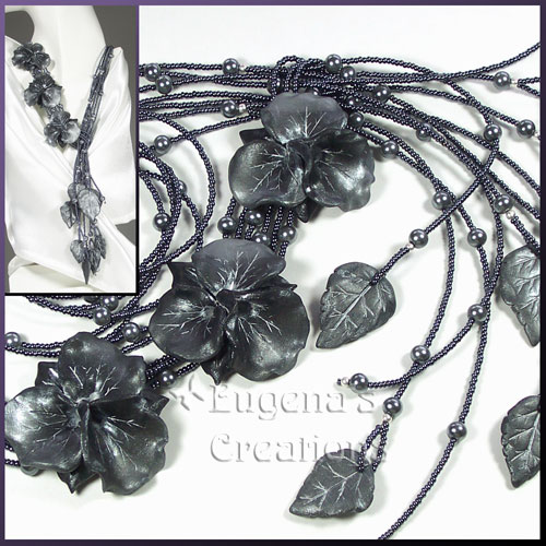 One-of-a-kind necklace with hand-sculpted orchids and leaves