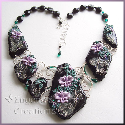 One-of-a-kind necklace with hand-sculpted orchids