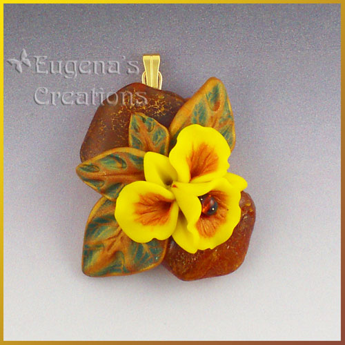One-of-a-kind pendant with amber and hand-sculpted orchid