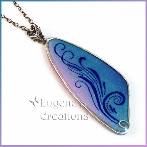 One-of-a-kind polymer clay and resin pendant with sterling silver bezel and swirl design